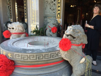These temple dogs look so happy. They look like they are guarding the prayer incense.