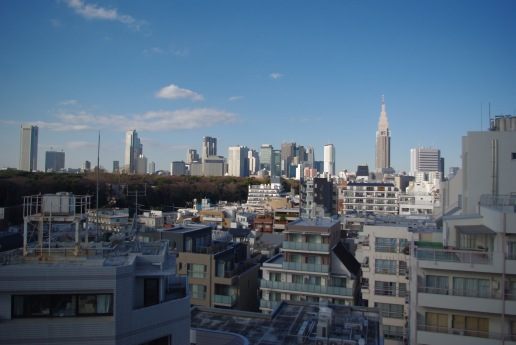 The view from our apartment. The greenery to the left is Meiji Temple park.